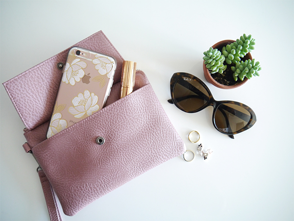 Matt and Nat x Indigo limited edition mauve Maya wristlet clutch bag has a front pocket with flap that's roomy enough for an iPhone 6S and a lipstick