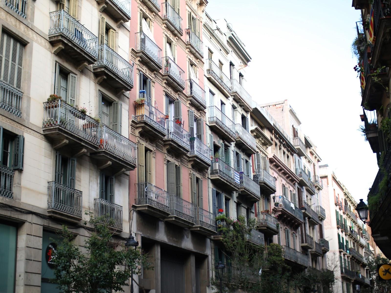 looking up at beautiful buildings in barcelona spain