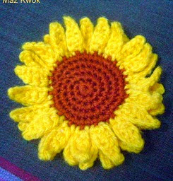http://www.mazkwok.com/2013/04/free-crochet-pattern-sunflower-applique.html