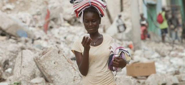Young Nigerian girl with mobile phones