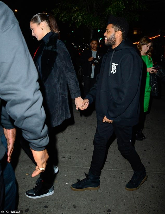 Bella Hadid and The Weeknd pictured out on a romantic dinner date New York as they rock matching outfits
