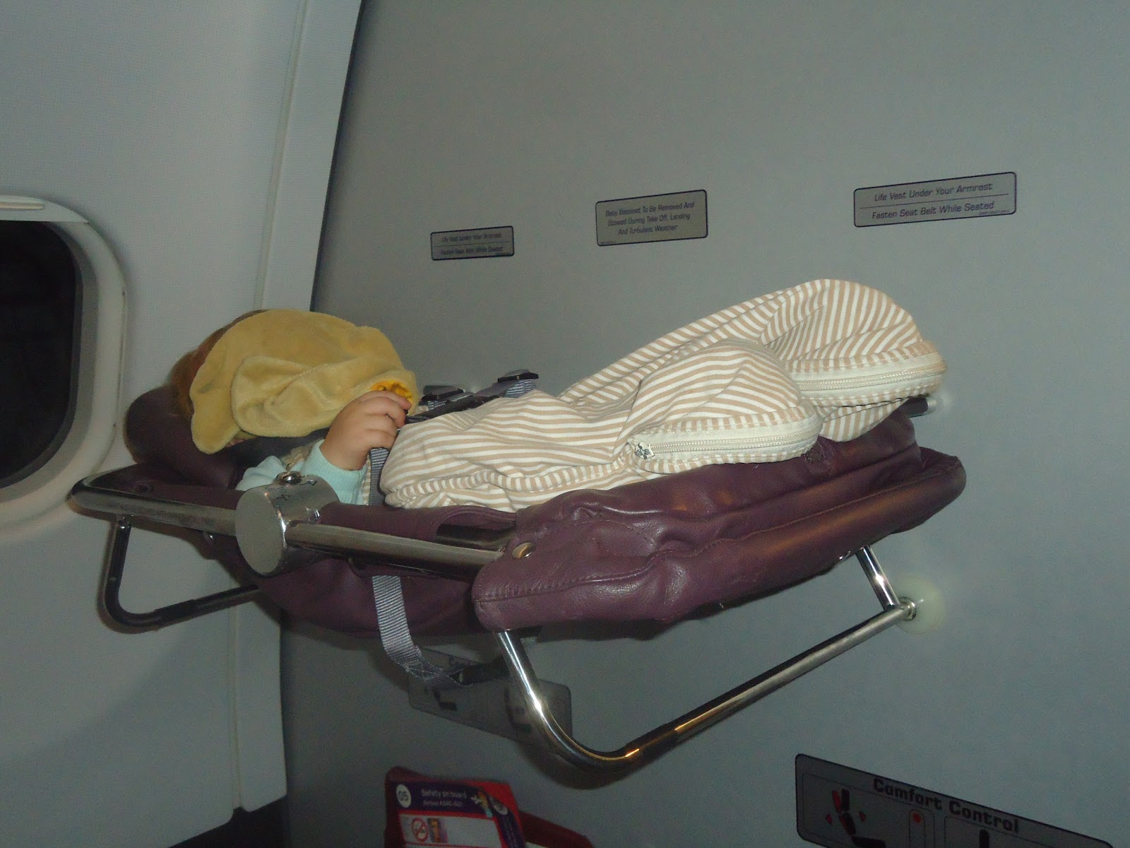 Baby Bassinet On Plane Jetlag And Mayhem Flight Review Virgin Premium Economy