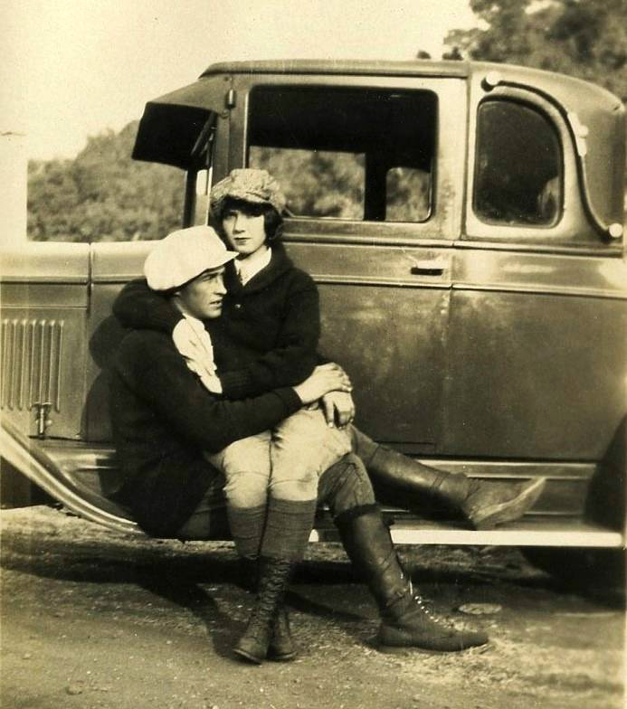 Fashion Couple On Running Board Of An Old Automobile, Ca
