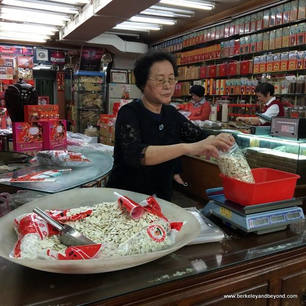 weighing seeds in shop on Dihua Street in Taipei, Taiwan