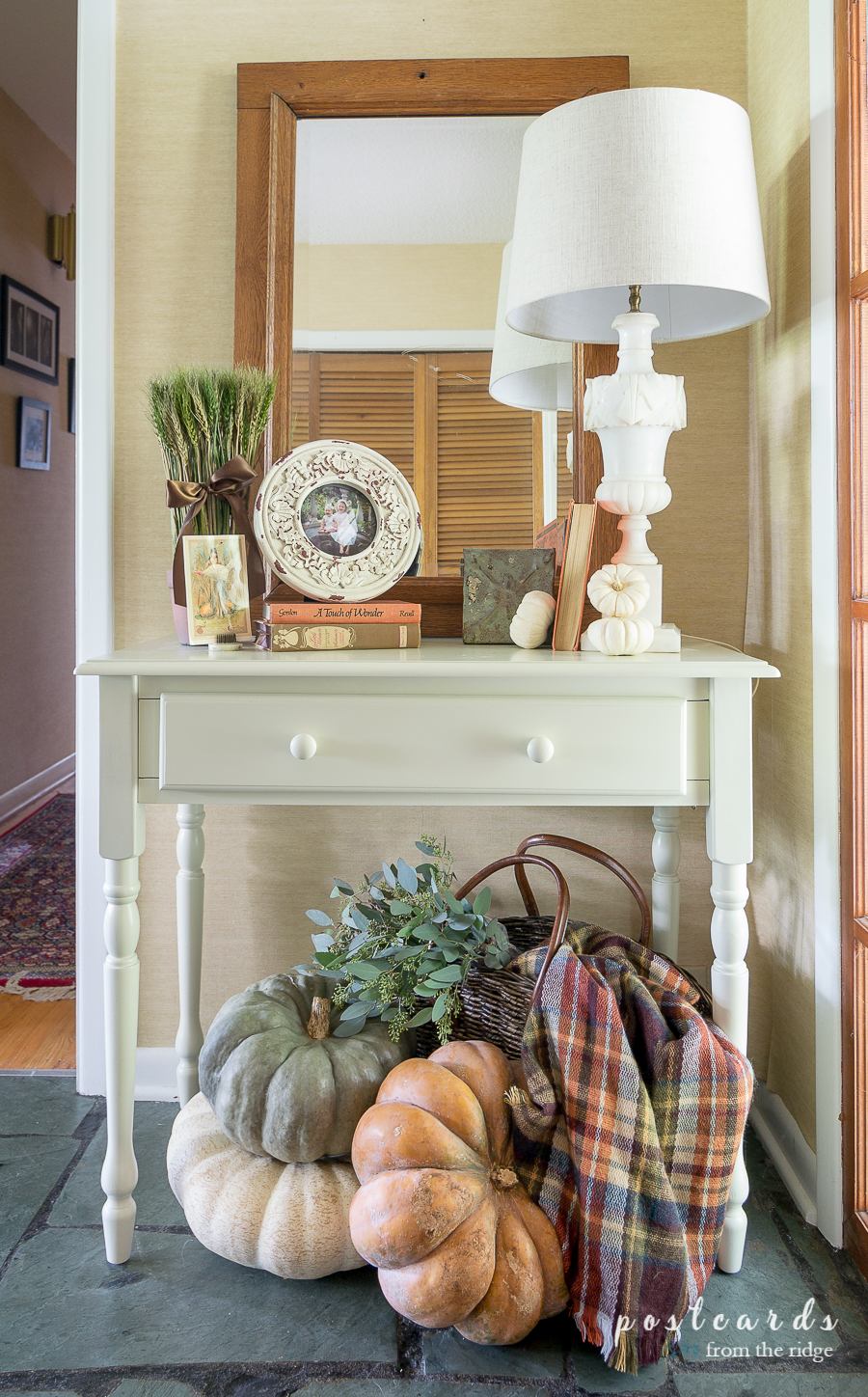 fall pumpkins and plaid blanket