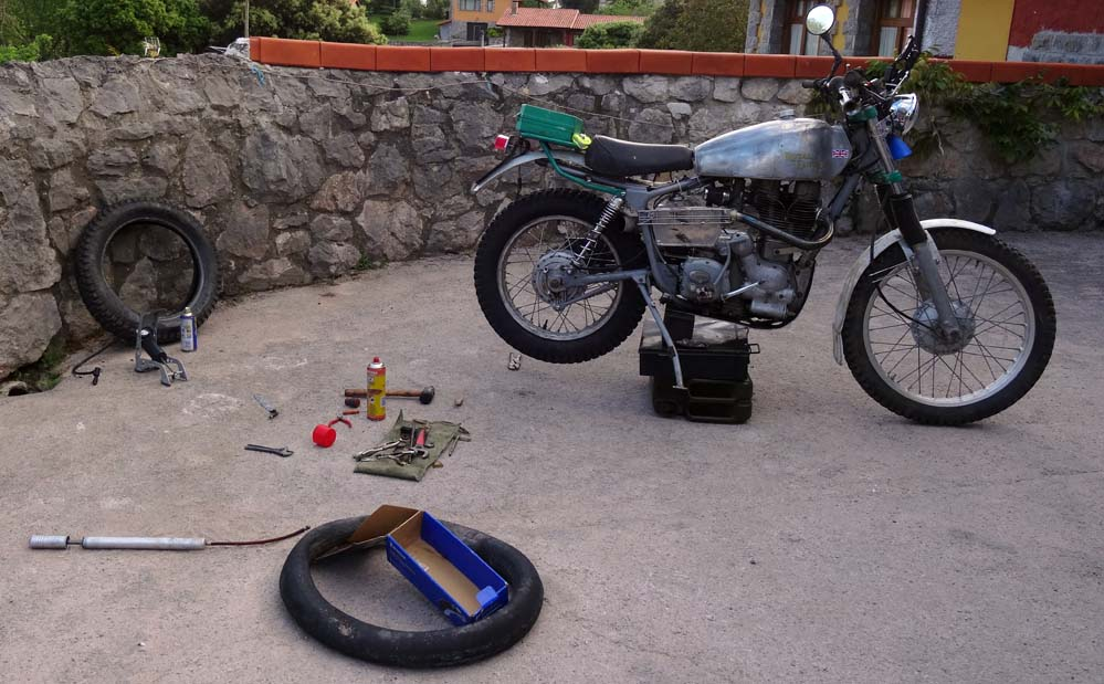 Royal Enfield flat tire being fixed.