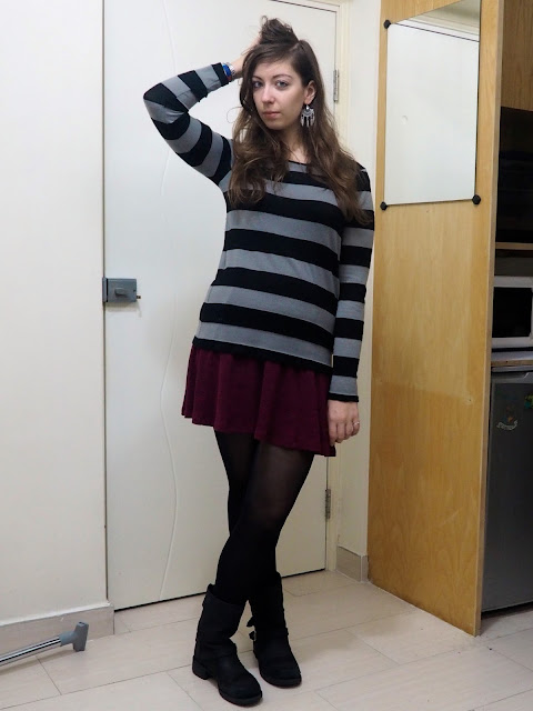 Work in Winter | outfit of black and grey striped jumper over short purple dress, with tight and black biker boots