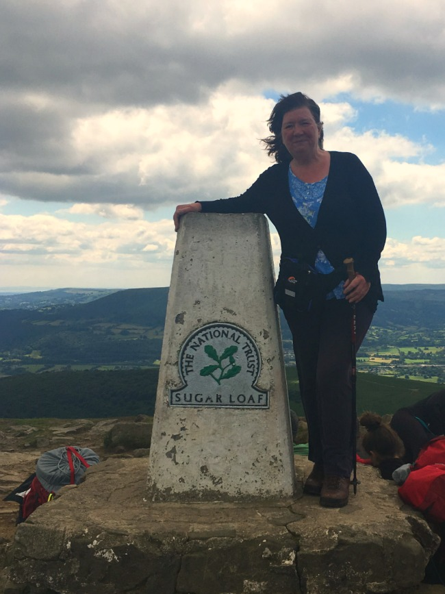A-Walk-up-Sugarloaf-adult-next-to-trig-point