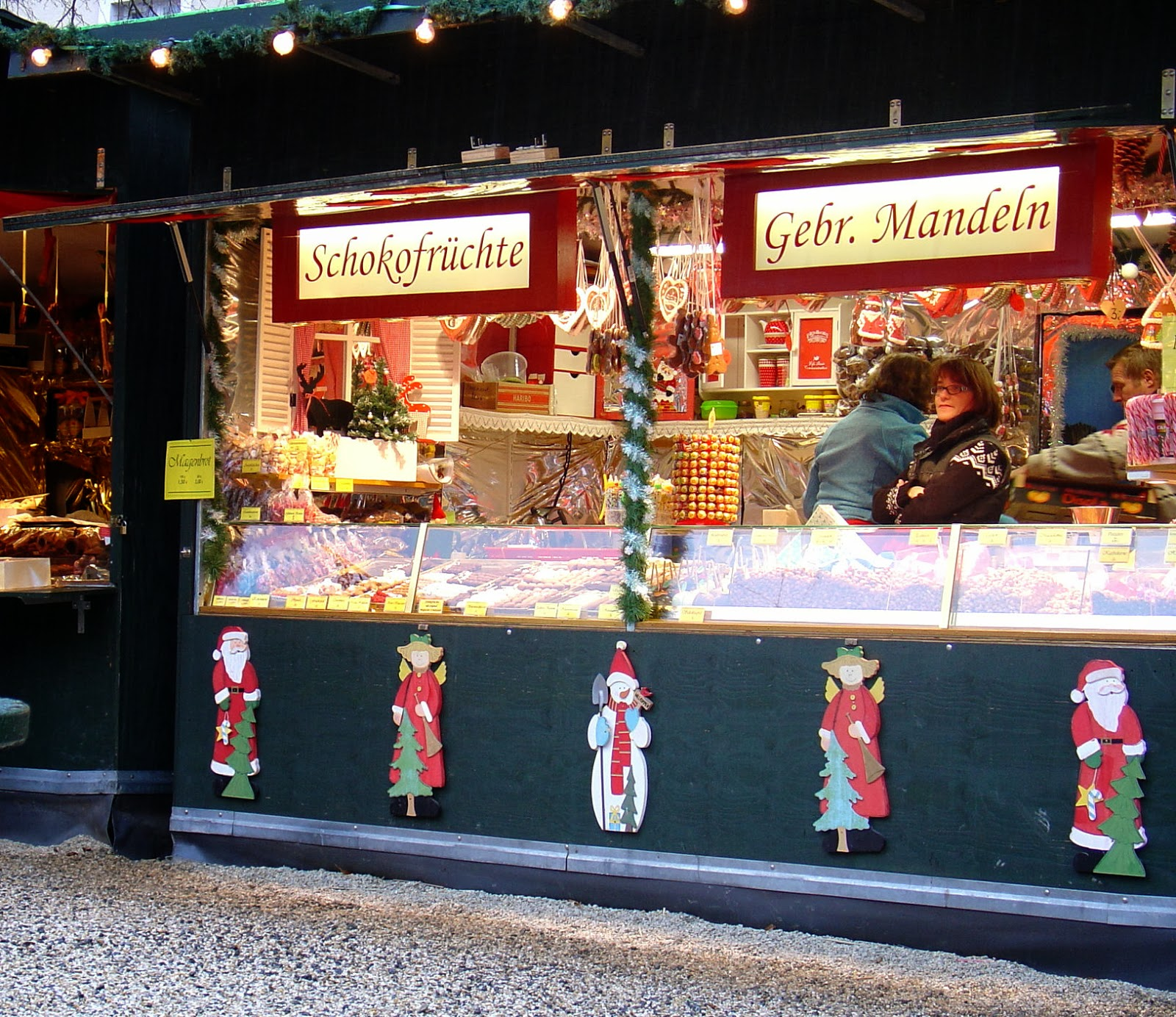 Colorful chalets brimming with gifts and tasty treats line the walkways at the market.