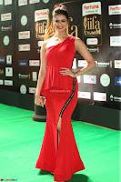 Meenakshi Dixit in Red One Shoulder Red Zipped up gown at IIFA Utsavam Award 86.JPG