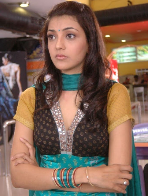 South Indian Hot Actress Kajal Agarwal Sad looking Face In Green Dress