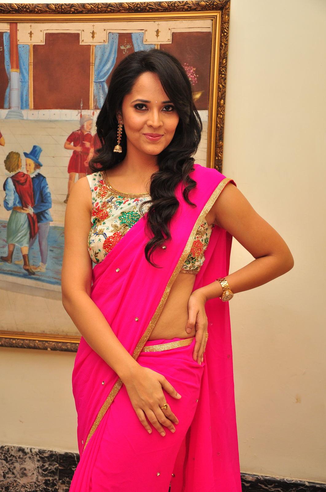 Glamorous Anasuya Navel Show Photos In Pink Saree