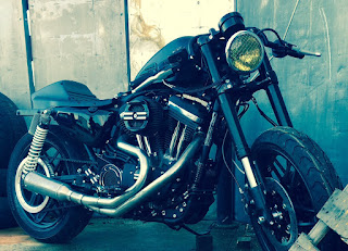 cafe tracker 1200 roadster by hd frosinone front right angle