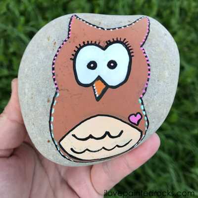 owl rock stone painted rock in the garden