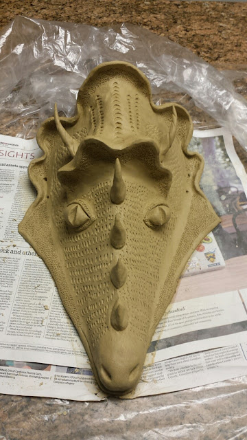 Clay dragon mask in progress, by Lily L.