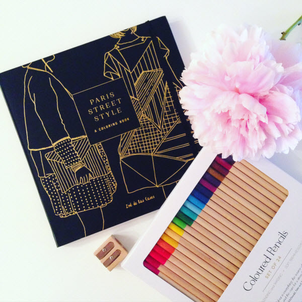 Paris Street Style Coloring Book by Zoe De Las Cases next to colored pencils and a peony. Colouring book and coloured pencils from Chapters Indigo #indigofaves.