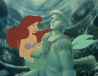 Ariel with a statue undersea The Little Mermaid 1989 animatedfilmreviews.filminspector.com