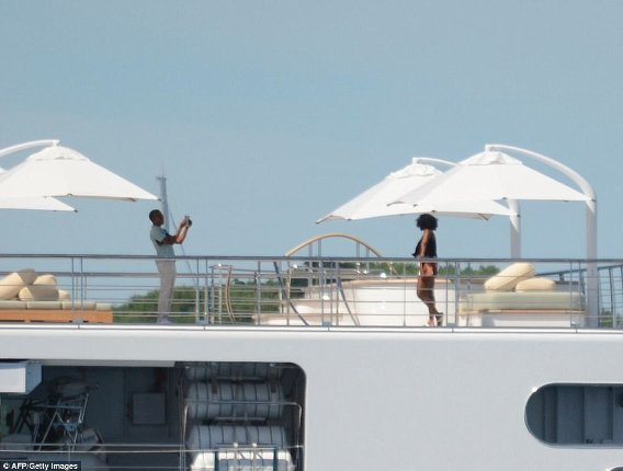 Barack Obama spotted taking photos of his wife Michelle aboard on a yacht