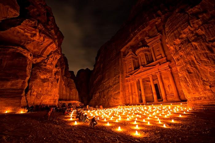 Amazingexplore Candles and moonlight illuminate Al-Khazneh, the iconic Treasury of Petra, Jordan