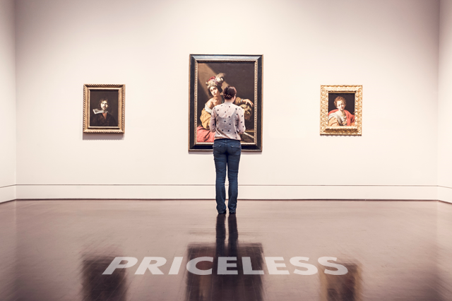 Woman looking at 3 paintings in a room. Priceless is written on the floor.
