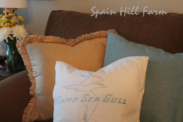 accent pillows add personality to your decor - vintage camp bag