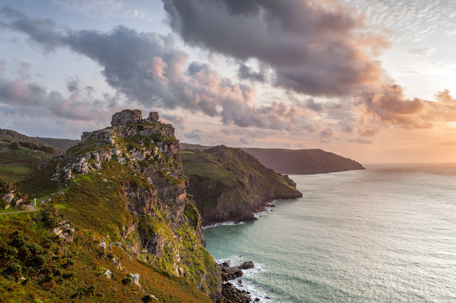 Tangerine clouds over the Valley of Rocks coastline at sunset in Exmoor