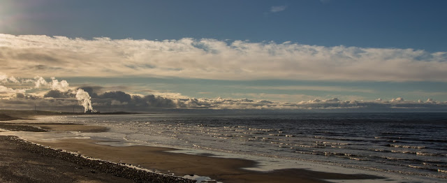 Photo of another view along the beach from Maryport towards Flimby