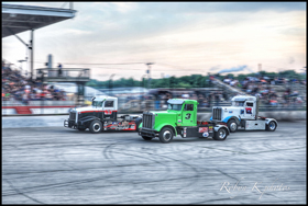 Cody Slowinski (#63), Allen Boles (#3) and Darren Proffitt (#27) battle for position during the first challenge race at Hawkeye Downs Speedway in Cedar Rapids, Iowa, on June 9th