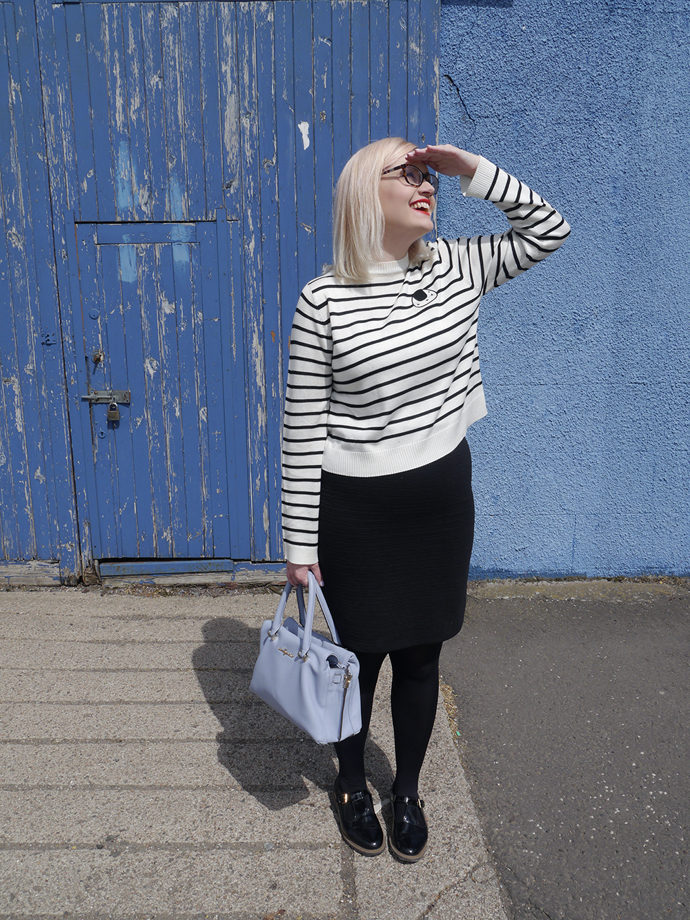 Scottish fashion blogger, Wardrobe Conversations, Jasper Conran bag from Debenhams, blue background, monochrome outfit inspiration, The Whitepepper top, sushi print, blue fashion shoot location, Dundee style blogger