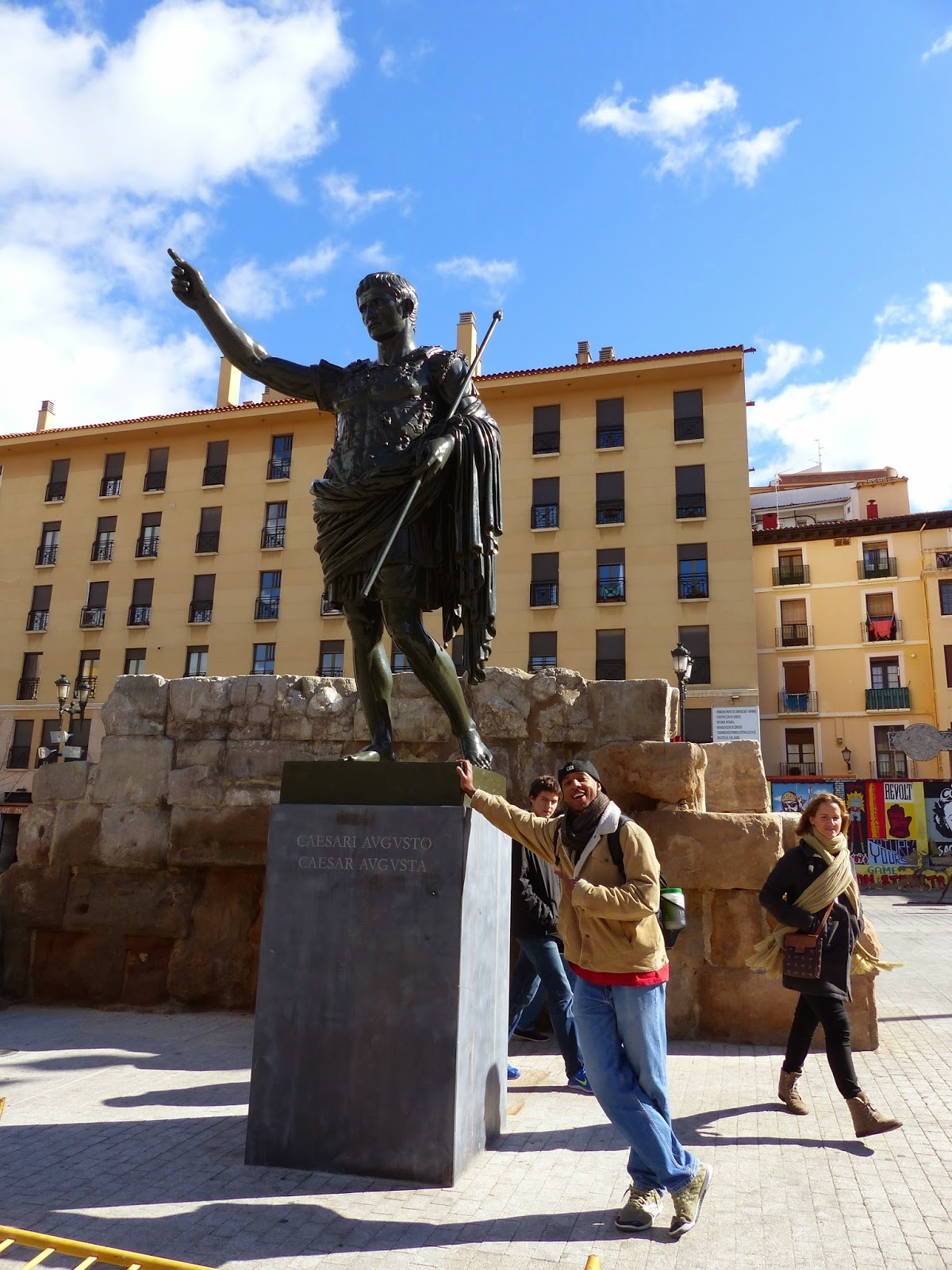 With the man, the one the city is named after, and Julius Cesar next to him