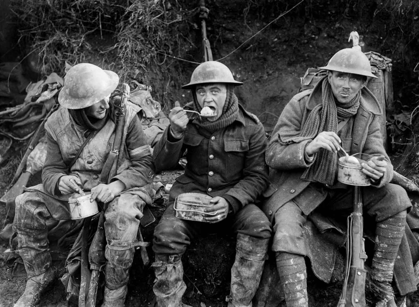 British soldiers eat hot rations in the Ancre Valley. October, 1916.