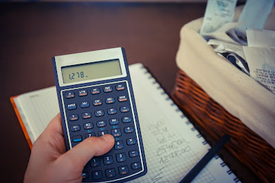 Calculator with pen and notebook