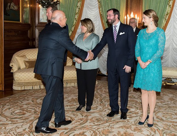 Prince Guillaume and Princess Stéphanie at New Year's reception. Princess Stéphanie wore Prada Lace Dress and Prada leather pumps, shoes, diamond earrings