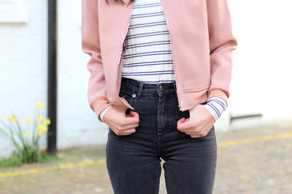 blush pink bomber jacket and mom jeans