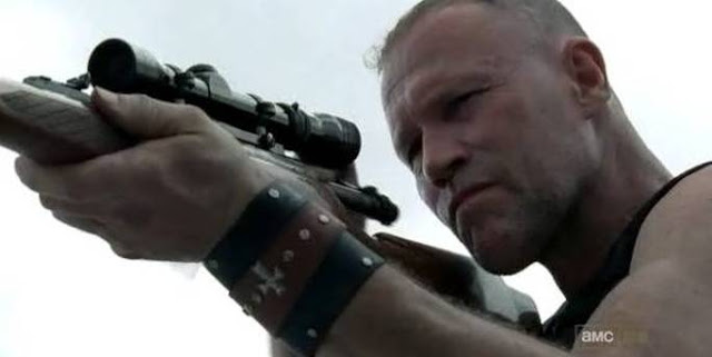 Merle Dixon starts shooting off his gun on the rooftop