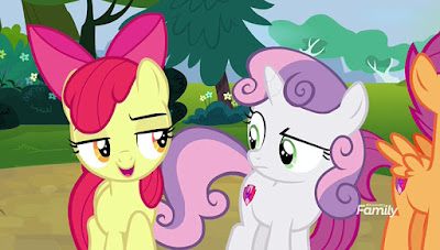 "Apple Bloom giving Sweetie Belle a ""scheming"" face"