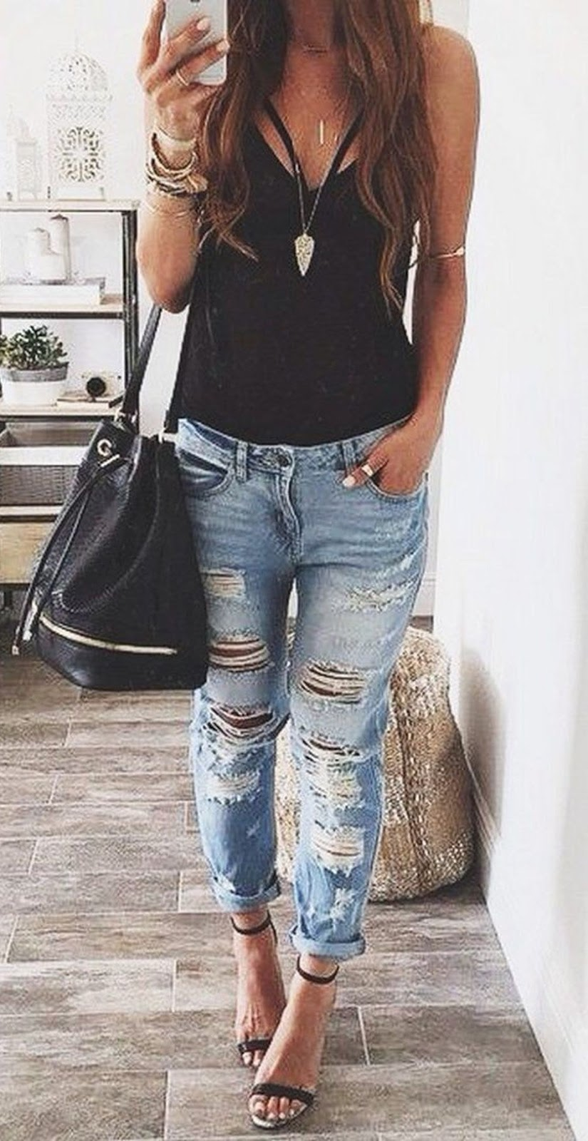 how to wear distressed jeans : bag + black top + heels