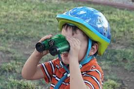Image result for looking through binoculars the wrong way