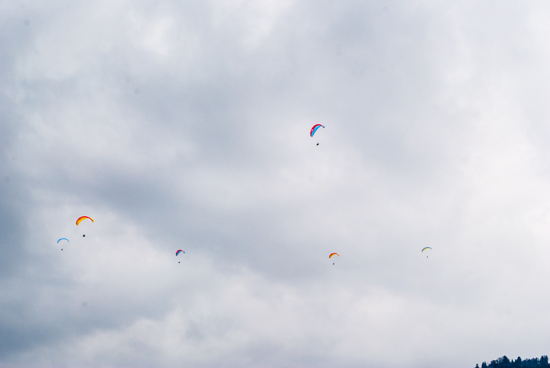 Paragliders gliding in the sky in interlaken Switzerland.