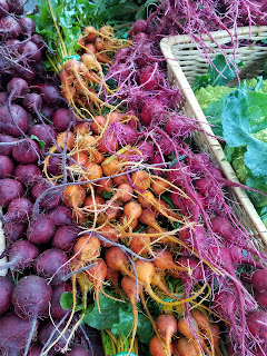A colorful pile of beets at a farmer's market