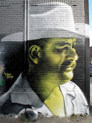 Arte Urbano un hombre con sombreo texano
