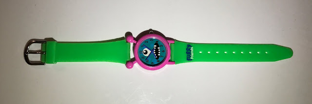 A Furry Friends Watch with a green pvc strap, silver buckle, pink rim and blue face