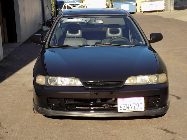 Integra with faded paint after overall paint job at Almost Everything Auto Body.