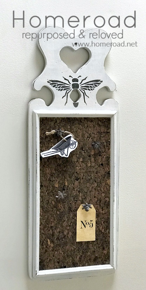 Bee stenciled cork board with bee thumb tacks.