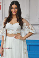 Telugu Actress Amyra Dastur Stills in White Skirt and Blouse at Anandi Indira Production LLP Production no 1 Opening  0022.JPG