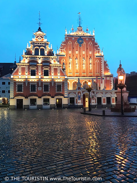 Latvia. House of Blackheads Riga, Early evening, rain. The Touristin