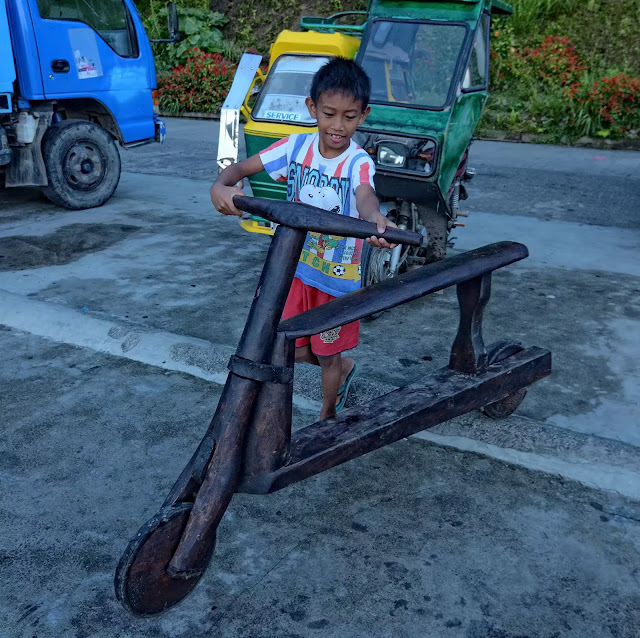 Young Kid  Wooden Bike Riders of Banaue Ifugao Cordillera Administrative Region Philippines