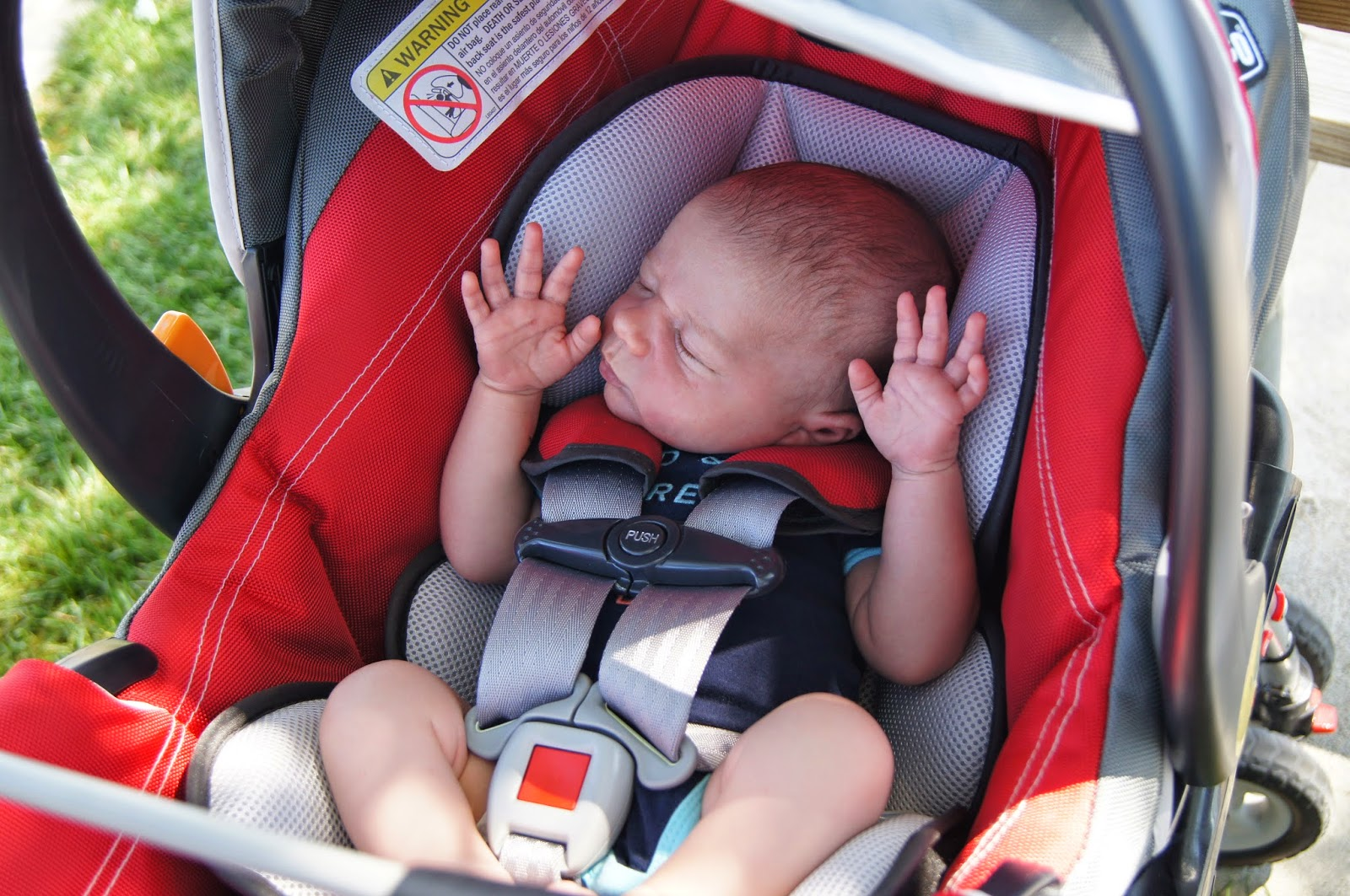 sleeping baby with hands up