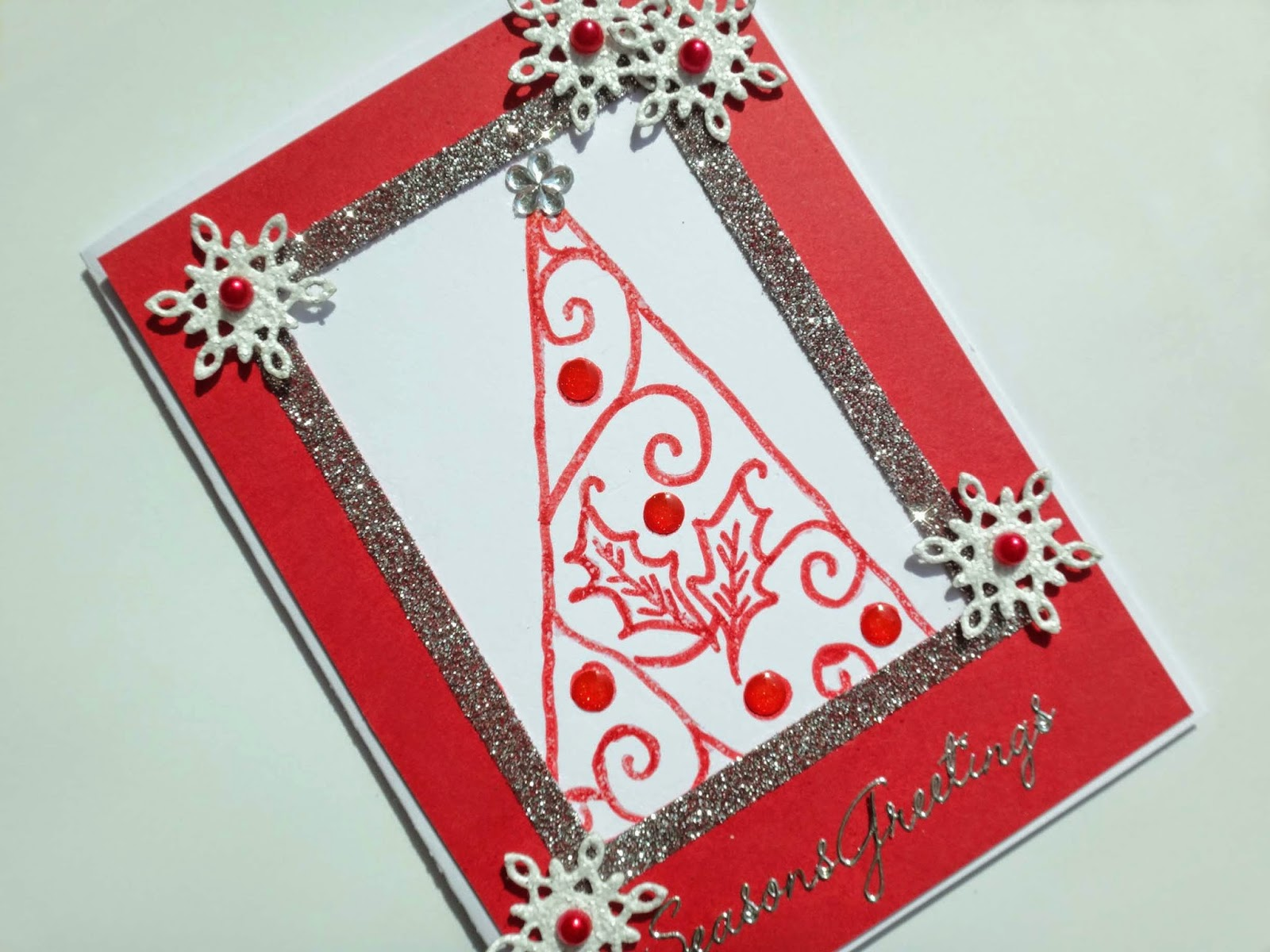 Hand made Christmas card with stamped tree, glitter and die cut snowflakes