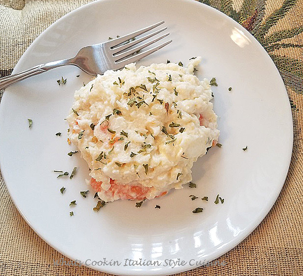 this is  smashed or mashed  together cauliflower and carrots mashed potatoes with sour cream and butter in keto low carb preparation. these low carb keto cauliflower mashed potatoes take the place of regular potatoes and copycat version of mashed potatoes. This is a Keto and Low Carb Recipe